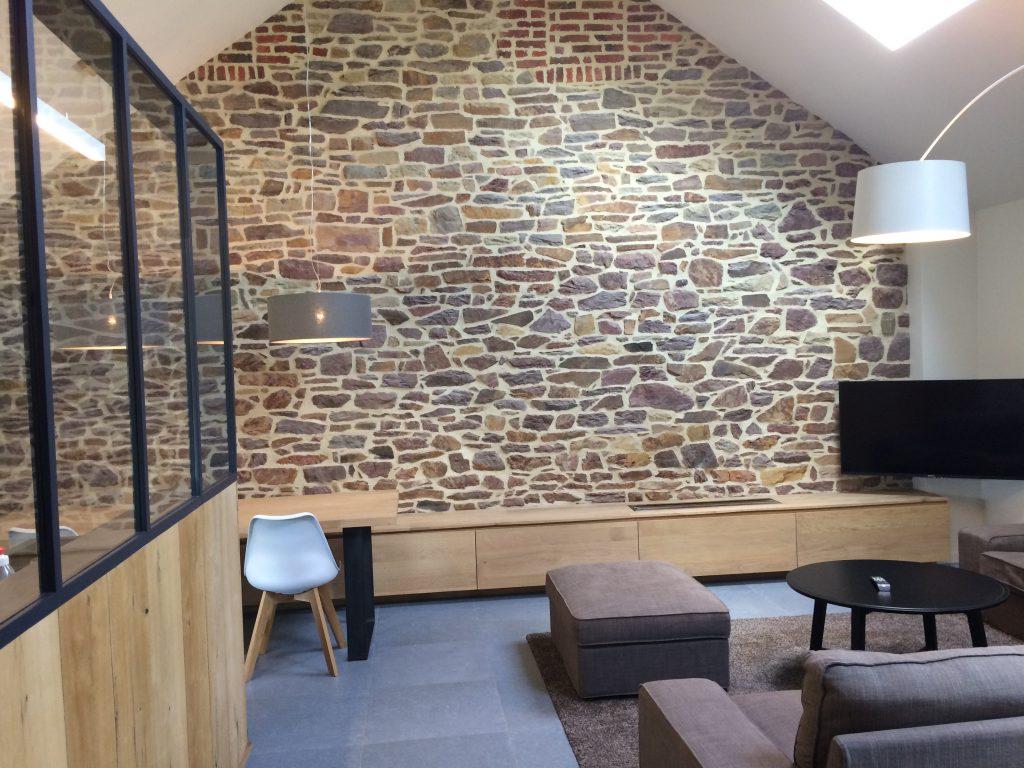 Trend een bakstenen muur in uw interieur