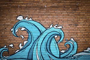 Mag je een muur schilderen die op de perceelgrens staat?
